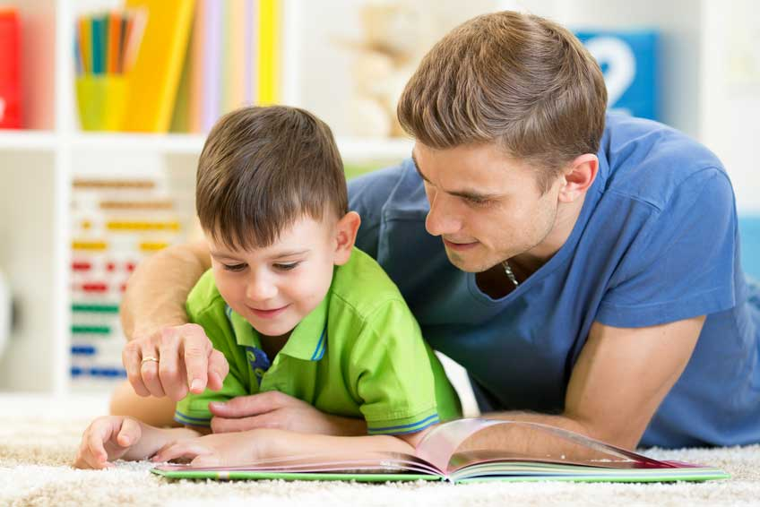 Boy reading with dad